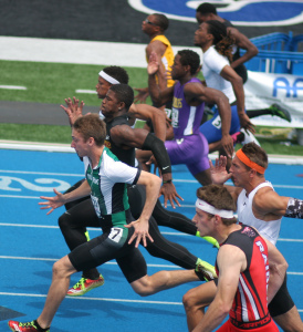 Alex Teague of York (green/white) was in the lead at this point in the IHSA 100m finals. Teague ran a 10.52 in the state prelims. Alex will be taking Activation with him to the University of Wisconsin.